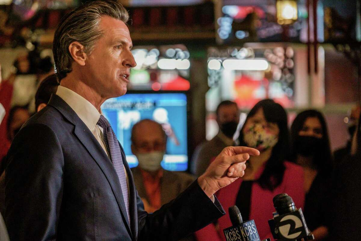 Gov. Gavin Newsom speaks to members of the media at the Far East Cafe in San Francisco during a campaign stop last week as he fights the effort to recall him.