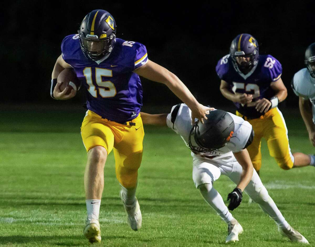 Ballston Spa fullback Darrien Insogna dismisses a tackle from Bethlehem linebacker Luke Diamond during their season opener on Friday, Sept. 3, 2021, in Ballston Spa, N.Y. (Jenn March, Special to the Times Union)