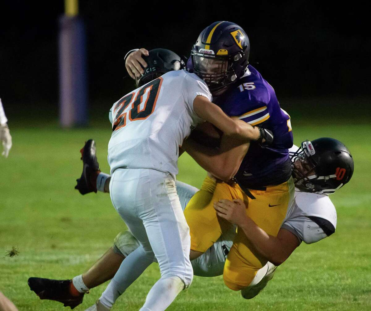 Bethlehem linebackers Luke Diamond (20) and Danilo Rosella tackle Ballston Spa fullback Darrien Insogna during their season opener on Friday, Sept. 3, 2021, in Ballston Spa, N.Y. (Jenn March, Special to the Times Union)