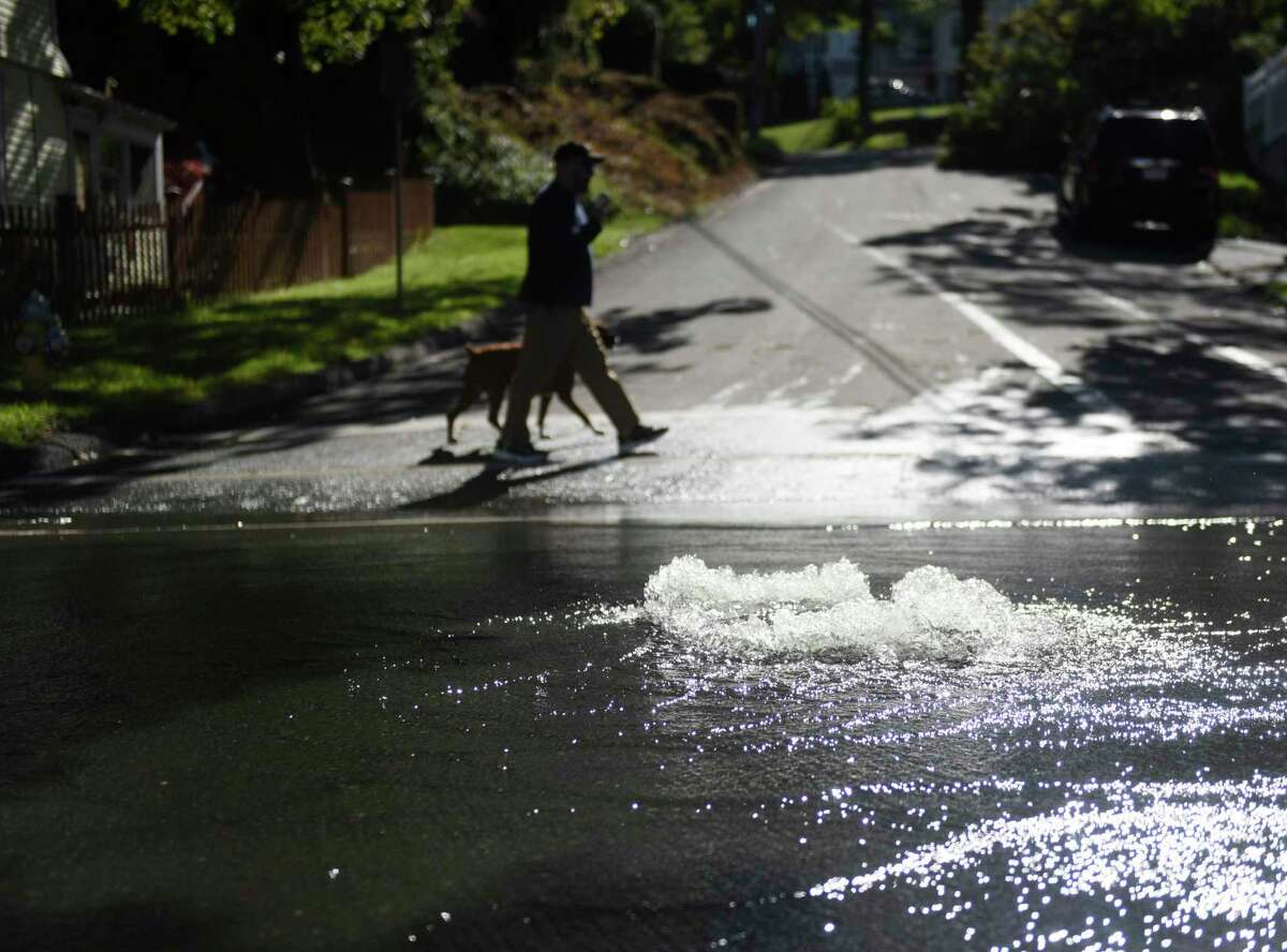 A storm drain spews water in Greenwich, Conn., on Thursday, Sept. 2, 2021, after torrential rains from the remnants of Hurricane Ida.
