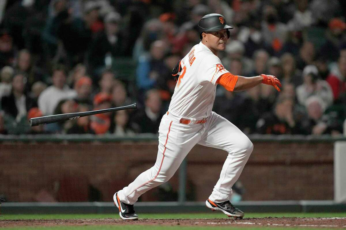 San Francisco Giants' Jose Quintana hits a single against the Milwaukee Brewers during the fifth inning of a baseball game Tuesday, Aug. 31, 2021, in San Francisco. (AP Photo/Tony Avelar)