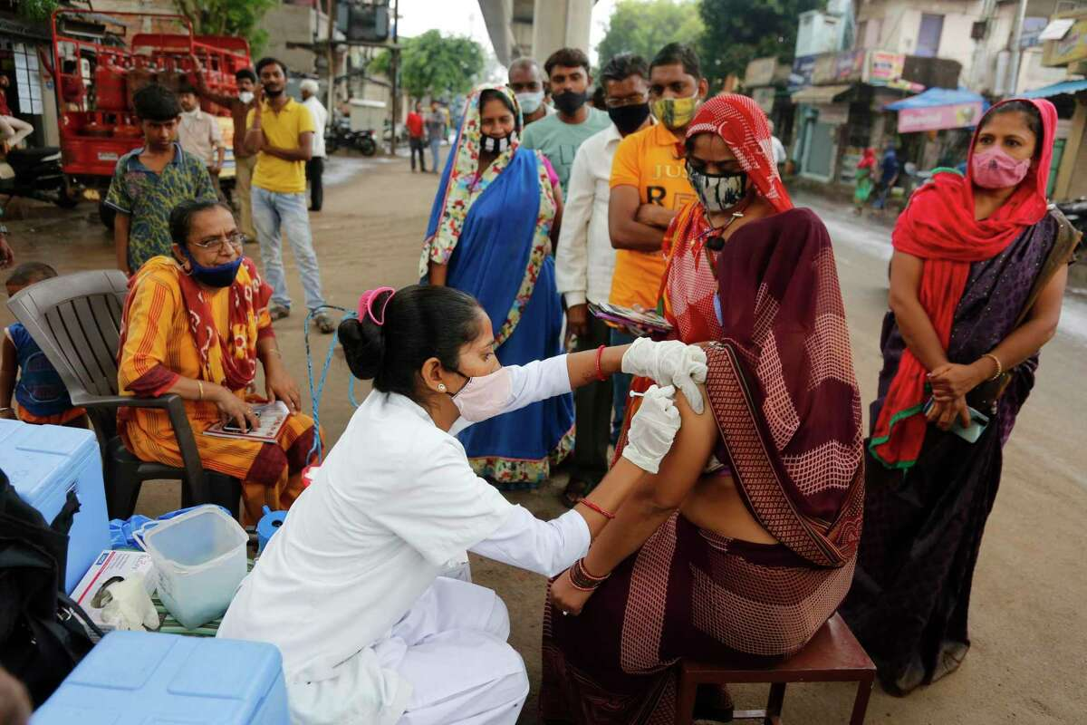 Some people argue the would-be booster shots should go to countries with low vaccination rates like India, where only one in 10 people are fully vaccinated.