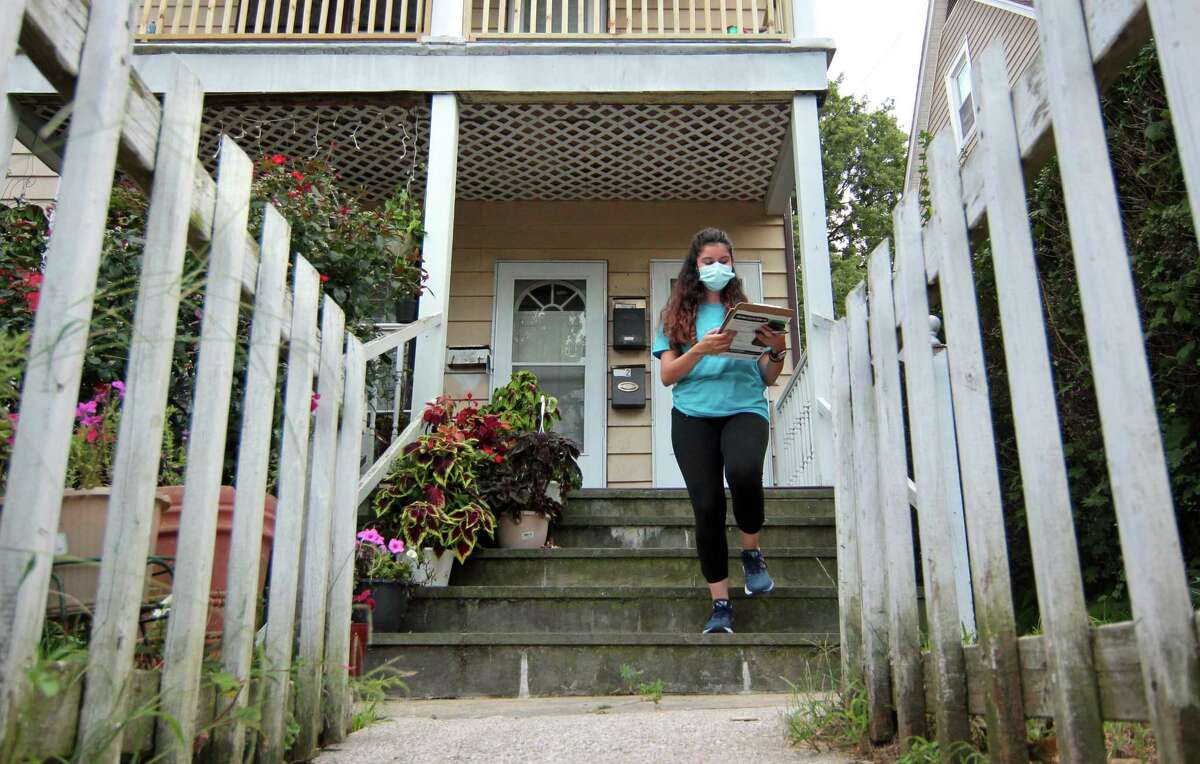 Community Health Care worker Beverly Reyes, with Family Centers of Stamford, goes door-to-door to encourage people to get the vaccine if they haven't already along Willams Street in Stamford, Conn., on Tuesday August 31, 2021.