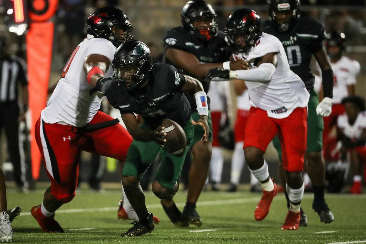 Hightower quarterback Kendron Penson, Jr., (10) is chased out of the pocket by Westfield defensive lineman Anthony Holmes, left, during the first half of a non-district high school football game at Hall Stadium Friday, Sept. 3, 2021 in Missouri City. Penson was sacked on the play.