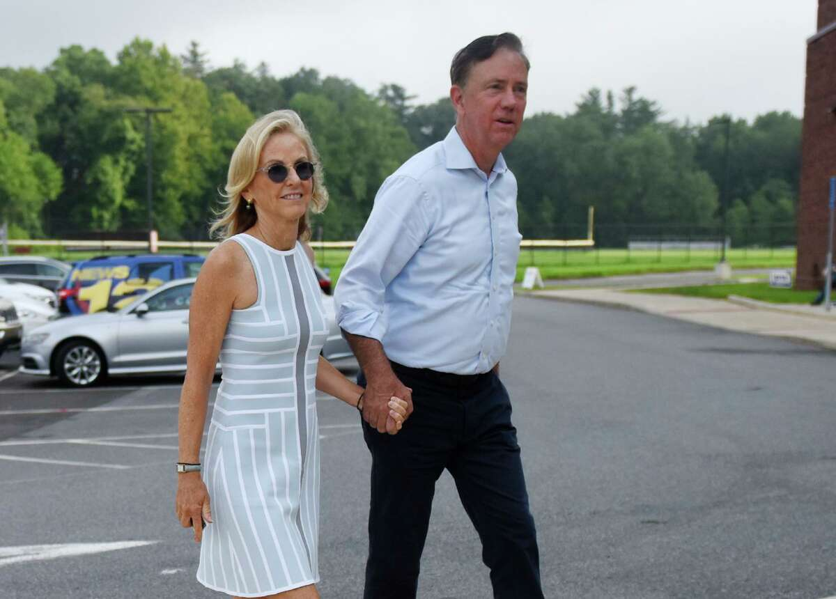 Then-candidate Ned Lamont and his wife, Annie, enter the Greenwich District 7 polling center to vote in the primary election at Greenwich High School in Greenwich, Conn. Tuesday, Aug. 14, 2018. The two live in town and were spotted dining together.