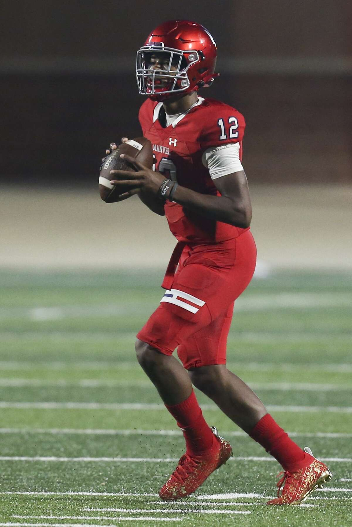 Manvel Mavericks quarterback Kaeden Smith (12) drops back in the pocket against the Crosby Cougars in the first half on September 3, 2021 at Freedom Field in Rosharon, TX.