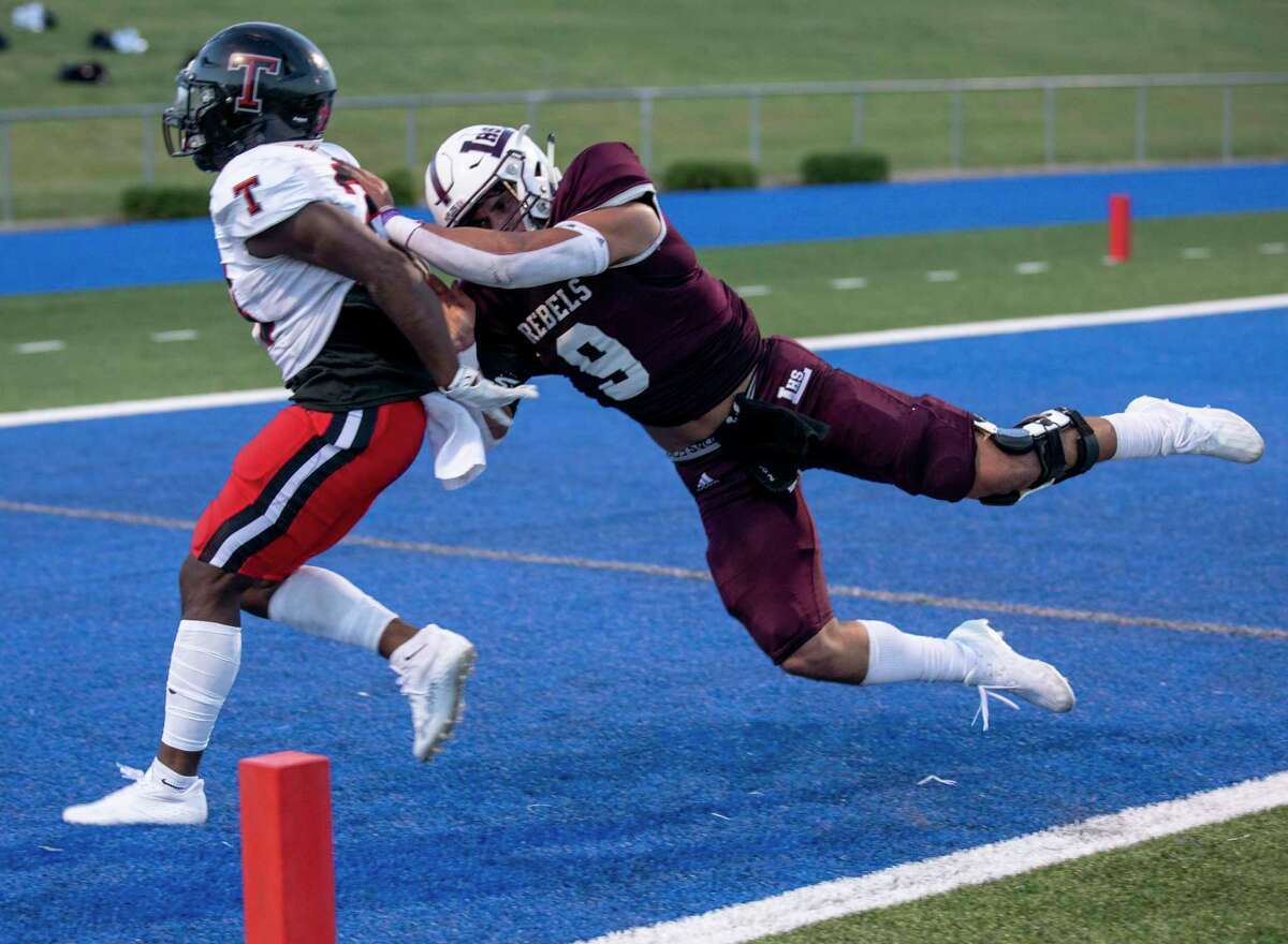 Legacy's Wesley Smith (9) pushes Tascosa's L'Travion Brown on Friday, Sept. 3, 2021 at Grande Communications Stadium. Jacy Lewis/Reporter-Telegram