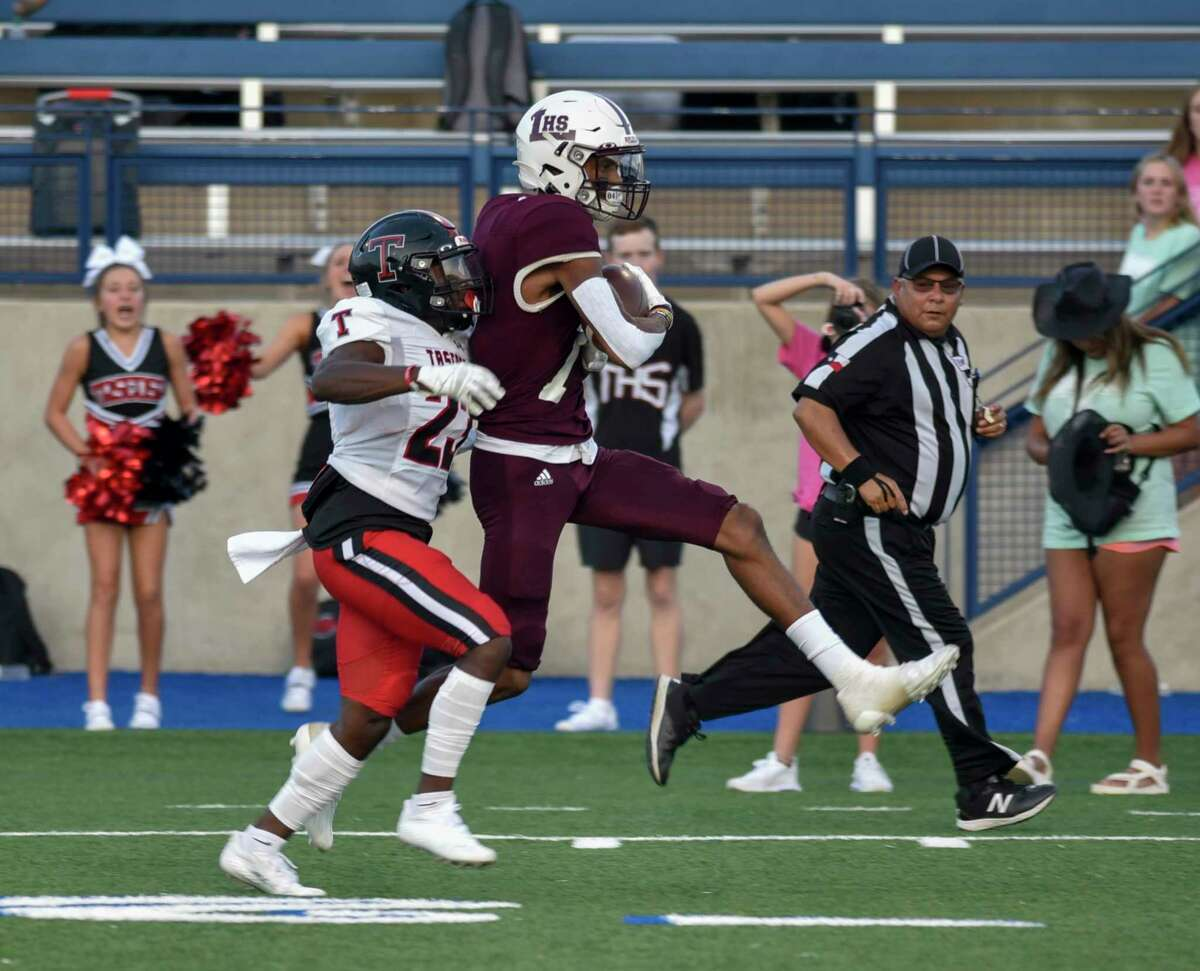 Tascosa's L'Travion Brown attempts to tackle Legacy's Chris Brazzell but Brazzell evades to score a touchdown Friday, Sept. 3, 2021 at Grande Communications Stadium. Jacy Lewis/Reporter-Telegram