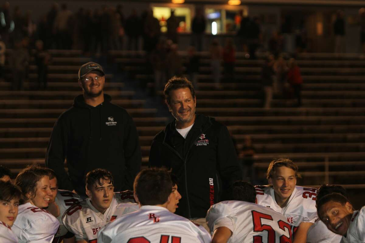 Bear Lake head coach John Prokes addresses his team following a 20-14 victory over Catholic Central.