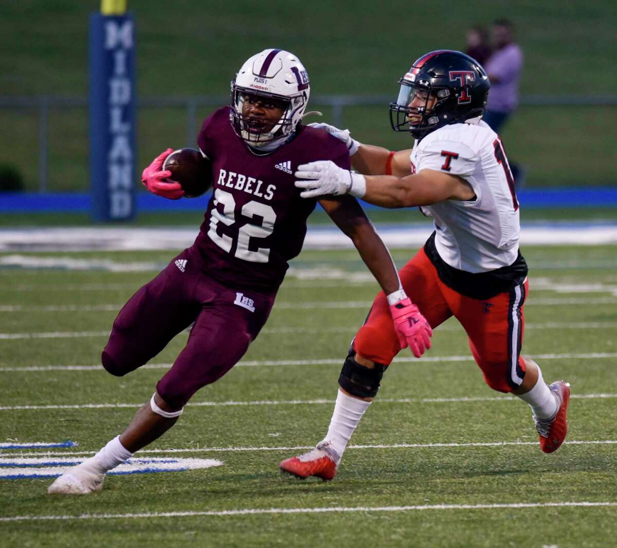 Legacy's Makhilyn Young (22) runs the ball as Tascosa's Lincoln White attempts a tackle Friday, Sept. 3, 2021 at Grande Communications Stadium. Jacy Lewis/Reporter-Telegram