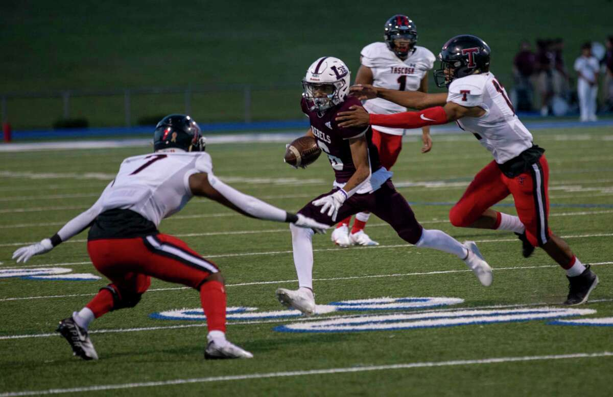 Legacy's Michael Valles (6) tries to evade Tascosa's Brenyn Barnes (7) and Andon Scroggins on Friday, Sept. 3, 2021 at Grande Communications Stadium. Jacy Lewis/Reporter-Telegram