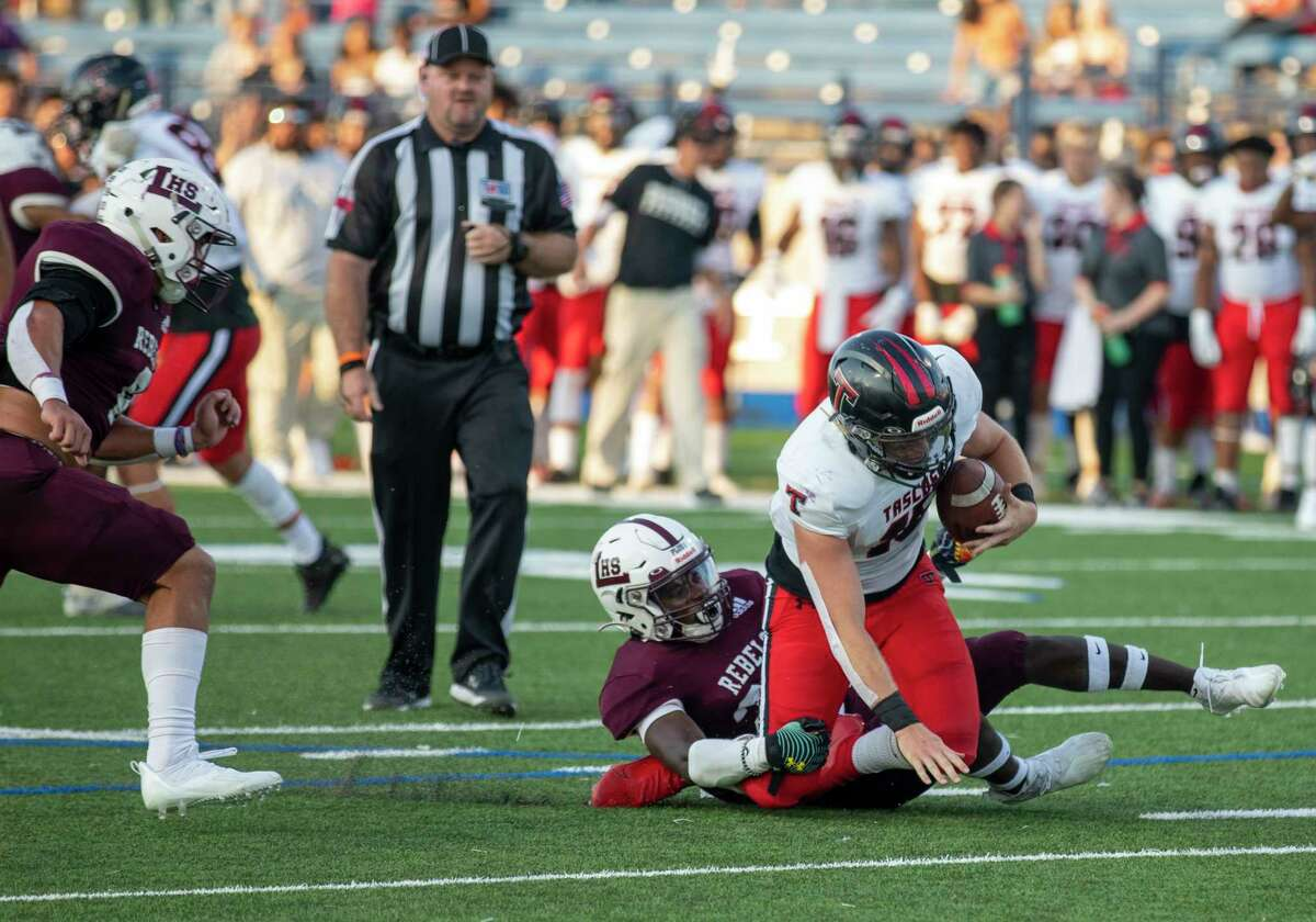 Legacy's Canyon Moses tackles Tascosa's BT Daniel as Legacy's Wesley Smith comes to assist Friday, Sept. 3, 2021 at Grande Communications Stadium. Jacy Lewis/Reporter-Telegram
