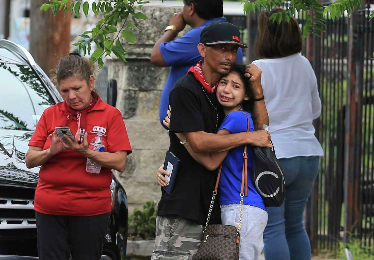 Family relatives become emotional after a standoff ended in gunfire and police killing a man identified as Eduardo Amezquita.