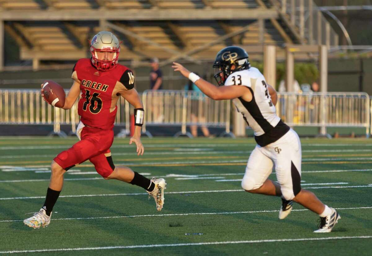 Caney Creek quarterback Rowdy Sebastian (16) looks for an opening to throw the ball while under pressure by Galena Park linebacker Sebastian Bernal (33) during the first quarter of a non-district football game at Moorhead Stadium on Friday, Sept. 3, 2021, in Conroe.