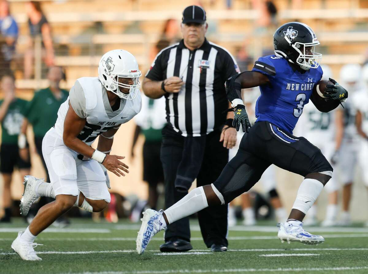 New Caney running back Kedrick Reescano (3) runs past Kingwood Park linebacker Joey Johnson (33) for a 31-yard gain during the first quarter of a high school football game at Randall Reed Stadium, Friday, Sept. 3, 2021, in New Caney.
