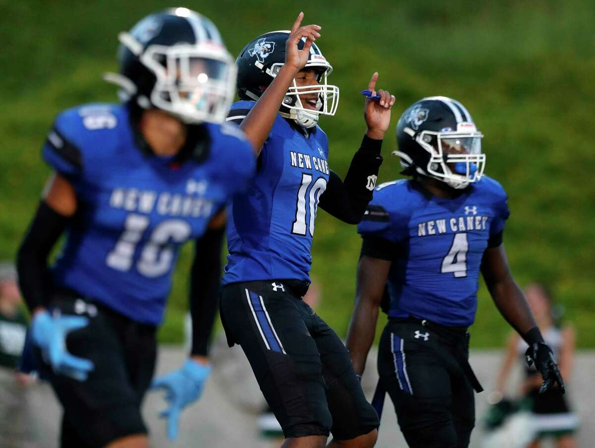 New Caney quarterback Cornelius Banks (10) reacts after running back Kedrick Reescano's 6-yard touchdown during the second quarter of a high school football game at Randall Reed Stadium, Friday, Sept. 3, 2021, in New Caney.