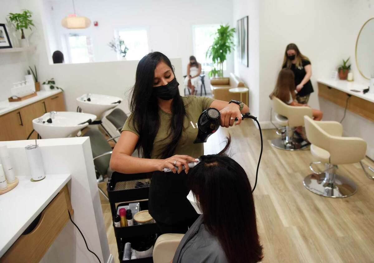 Head stylist Julie Jasaroska works with a customer at La Brosse Dry Bar in the Cos Cob section of Greenwich, Conn. Tuesday, Aug. 31, 2021. The salon located in Mill Pond Shopping Center opened over the summer and offers blow dry services, keratin treatment, and bridal hair styling.