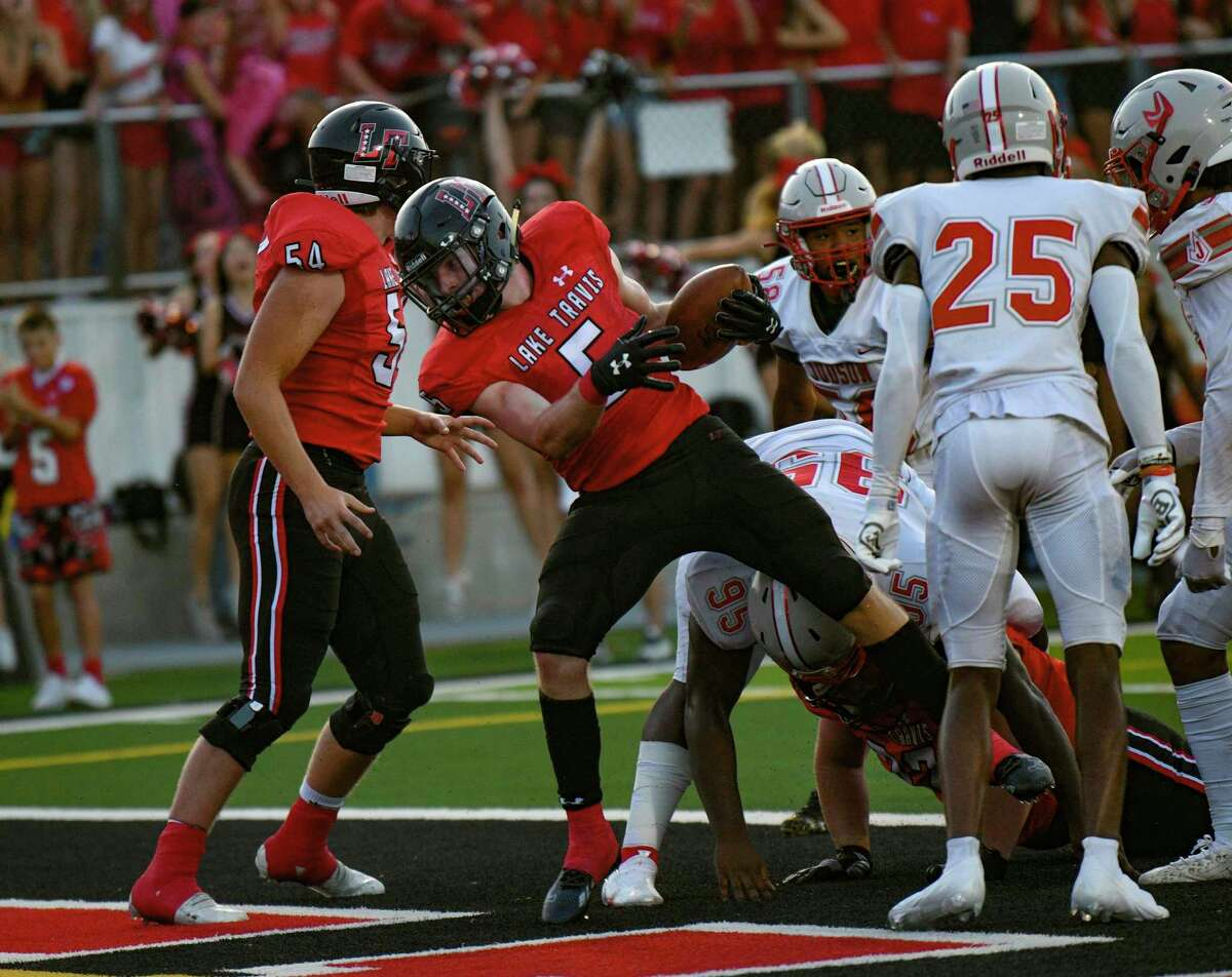 Lake Travis quarterback Isaac Norris scores against Judson during high school football action at Cavalier Stadium on Friday, Sept. 3, 2021.