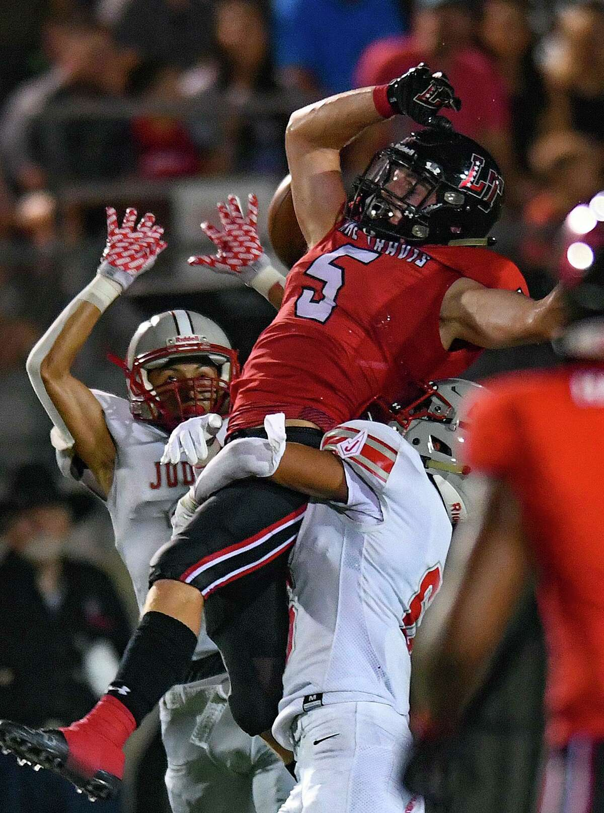 Judson defenders zero in on Lake Travis receiver Isaac Norris during high school football action at Cavalier Stadium on Friday, Sept. 3, 2021.