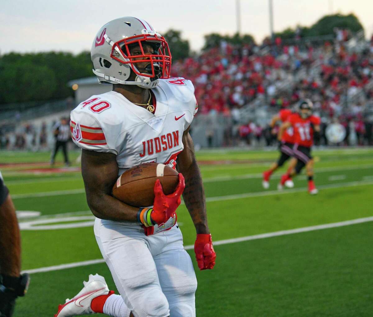 Judson's Marvin Beasley runs for a first-quarter score against Lake Travis during high school football action at Cavalier Stadium on Friday, Sept. 3, 2021.
