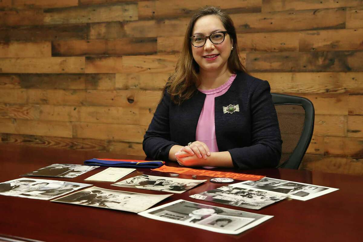 Sarah Zenaida Gould, executive director of the Mexican American Civil Rights Institute, sits with items from the institutes growing archive Friday. She has served as the interim director for just over a year but was named the permanent director recently.