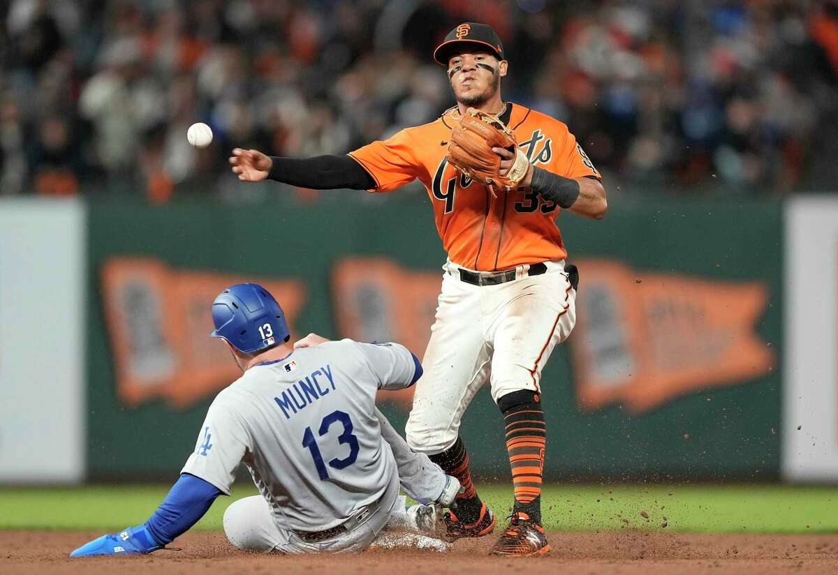 SAN FRANCISCO, CALIFORNIA - SEPTEMBER 03: Thairo Estrada #39 of the San Francisco Giants completes the double play throwing over Max Muncy #13 of the Los Angeles Dodgers in the top of the six inning at Oracle Park on September 03, 2021 in San Francisco, California. (Photo by Thearon W. Henderson/Getty Images)
