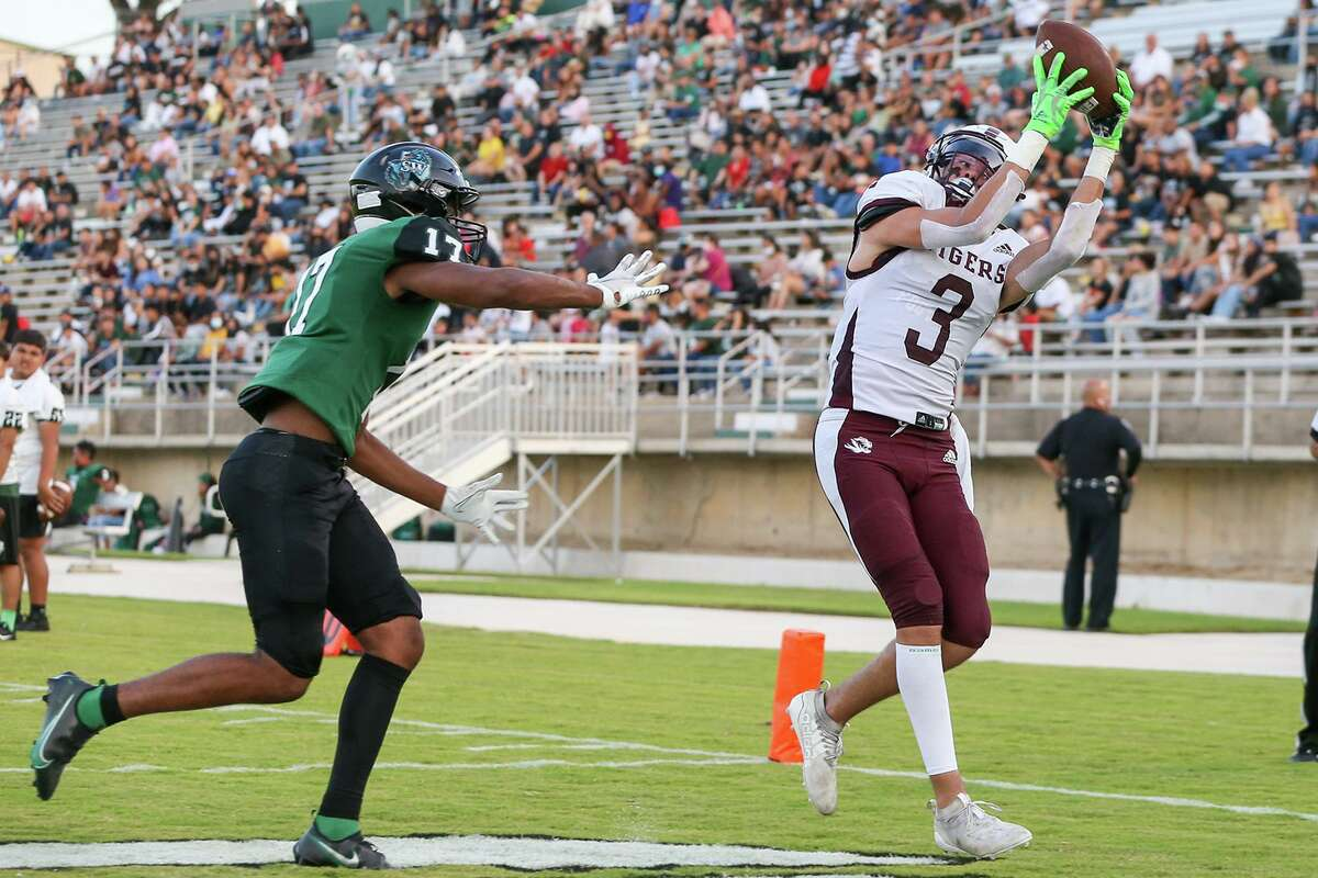 Floresville's Preston Feeeman pulls down an 11-yard touchdown reception in the end zone past Southwest's Charles Stemley during the first half of their high school football game at Dragon Stadium on Friday, Sept. 3, 2021. Floresville beat Southwest 36-13.