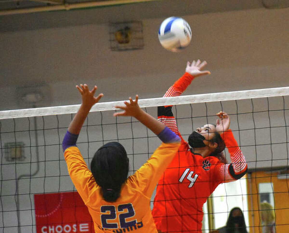 Edwardsville's Sydney Harris goes up for an attack during the first game against Rosati-Kain on Friday in the Tiger Classic.