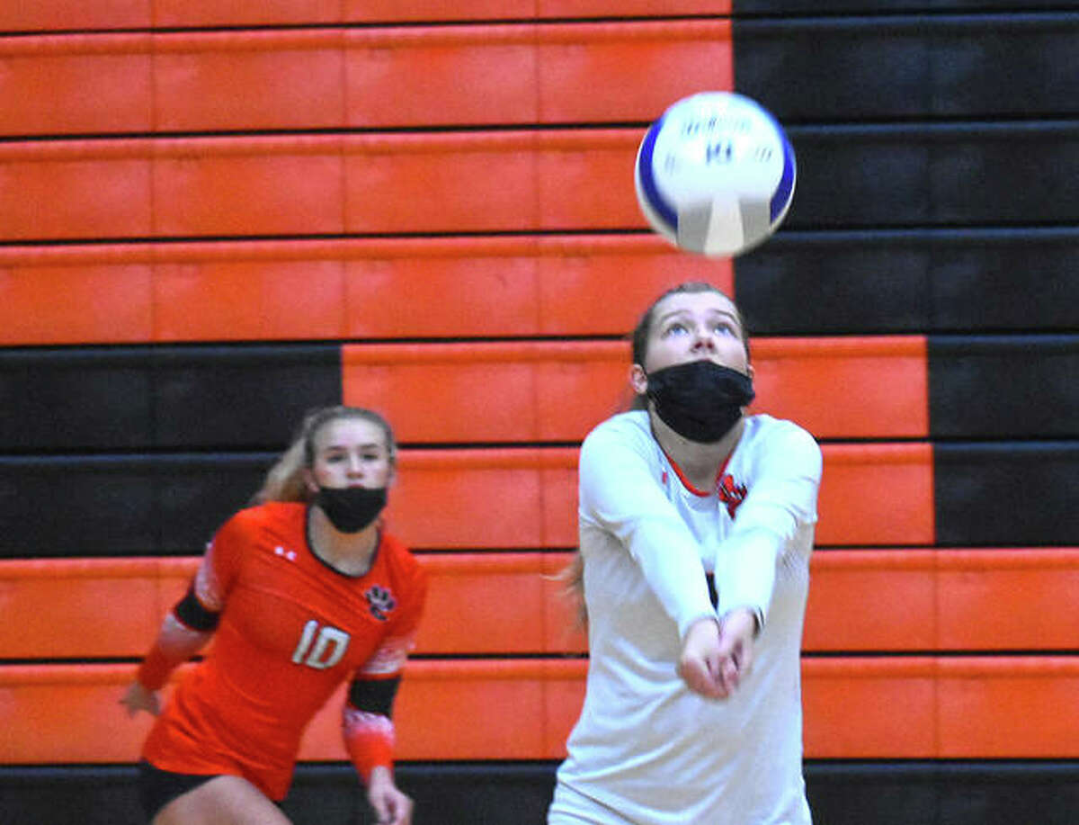 Edwardsville's Kaitlyn Conway keeps the volley alive with a bump during the second game against Rosati-Kain on Friday in the Tiger Classic.