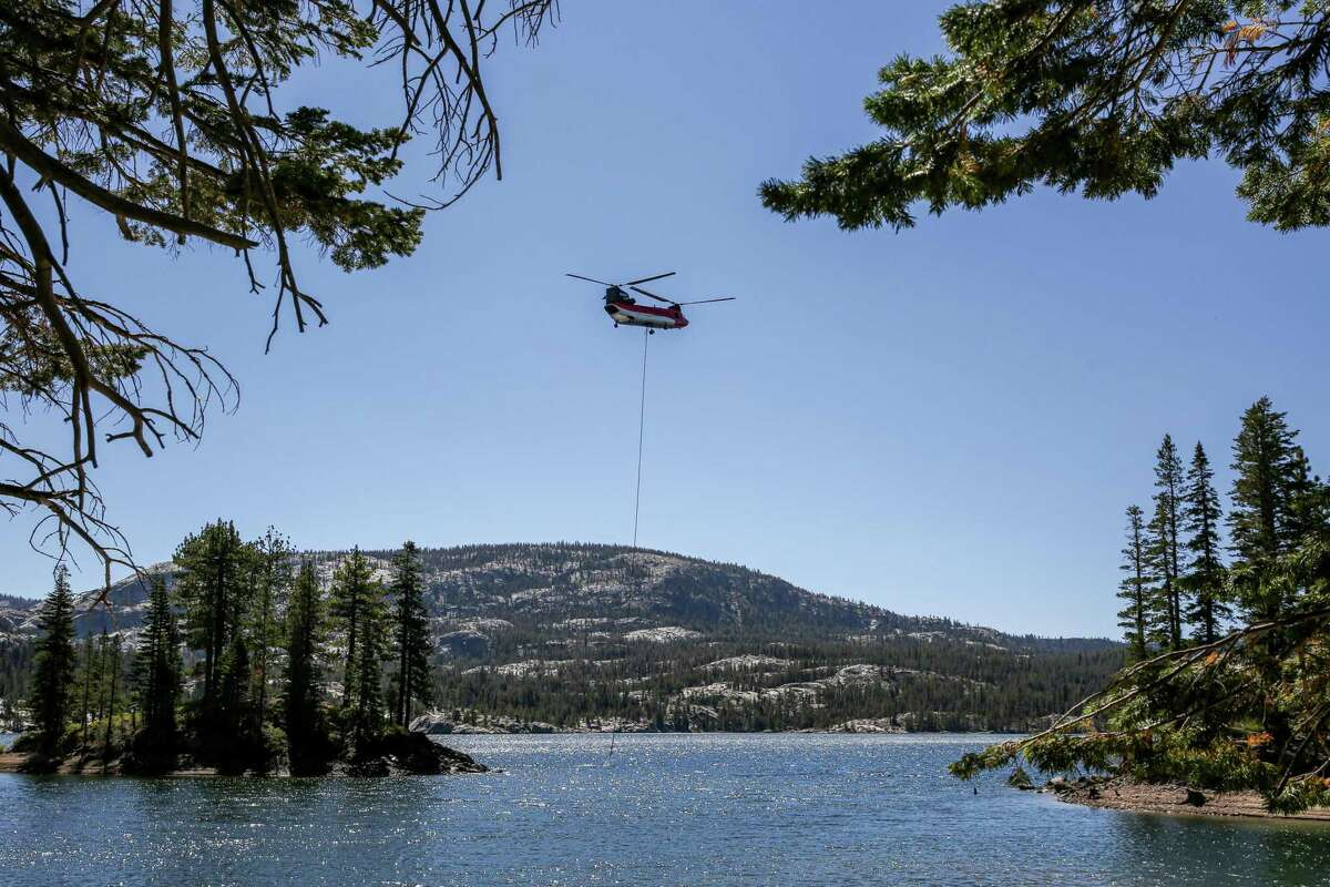 A heavy lift helicopter can be seen on a ridge near Kirkwood Mountain Resort on Wednesday, Sept. 1, 2021.