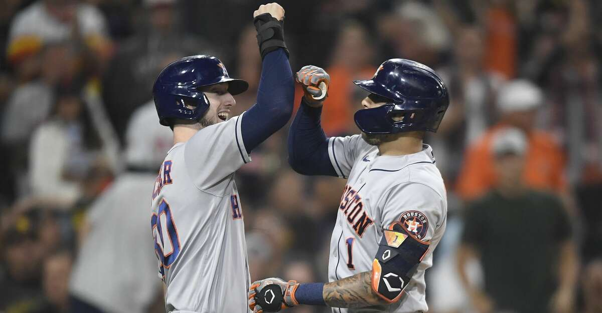 Carlos Correa #1 of the Houston Astros is congratulated by Kyle Tucker #30 after hitting a three-run home run during the fourth inning of a baseball game against the San Diego Padres at Petco Park on September 3, 2021 in San Diego, California. (Photo by Denis Poroy/Getty Images)