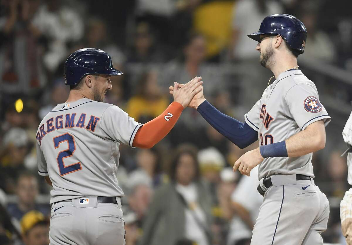 SAN DIEGO, CA - SEPTEMBER 3: Kyle Tucker #30 of the Houston Astros is congratulated by Alex Bregman #2 after hitting a two-run home run during the eighth inning of a baseball game against the San Diego Padres at Petco Park on September 3, 2021 in San Diego, California. (Photo by Denis Poroy/Getty Images)
