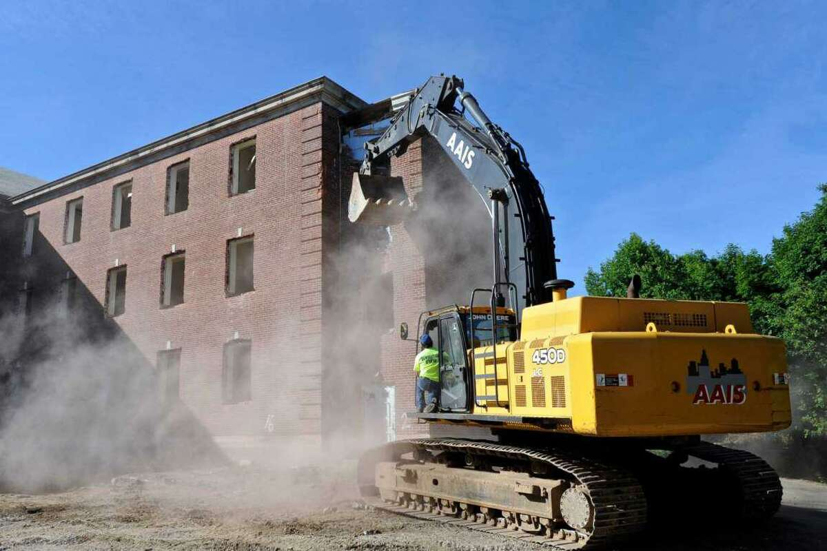 Demolition of Canaan House on the Fairfield Hills Campus, in Newtown, on Wednesday morning. June 15, 2016, in Newtown, Conn.
