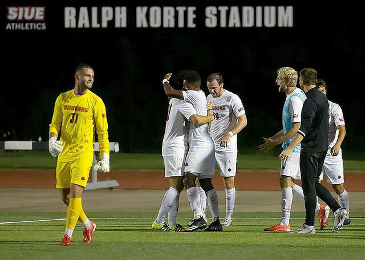 SIUE's Alex Segura, center, is congratulated by teammates after scoring the winning goal in the 98th minute of Friday night's home opener at Korte Stadium.