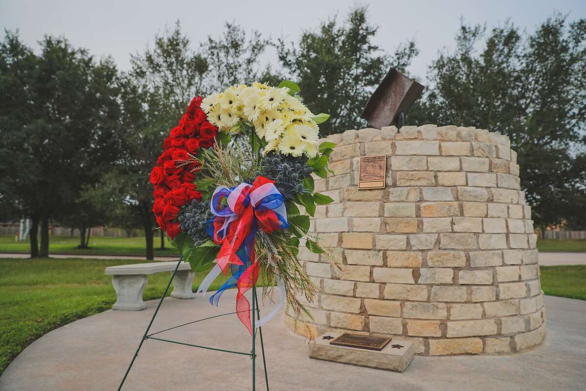 The Cy-Fair Fire Department holds its annual 9/11 memorial ceremony at Station 11 in Cypress in 2020. Outside the station, a memorial sculpture features a piece of an I-beam from the World Trade Center atop 343 bricks in honor of the 343 firefighters who died during 9/11.