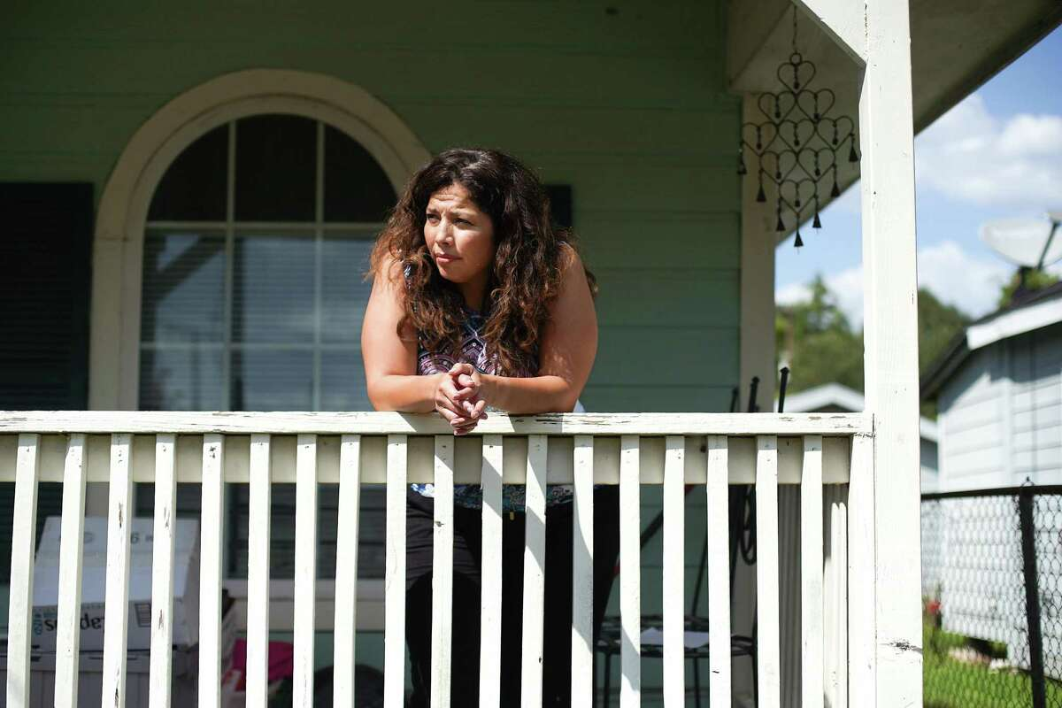 Vicki Cruz on her porch near the Port of Houston in Houston on Tuesday, Aug. 24, 2021.