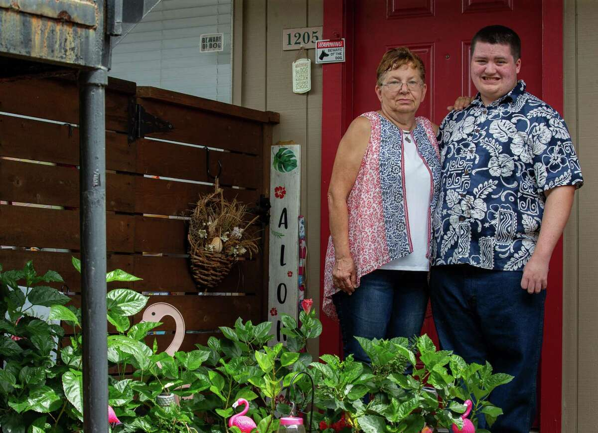 Wendy Christoph, left, and her grandson Dean Larson, 15, pose for a photograph on Friday, Aug. 27, 2021, in Houston.