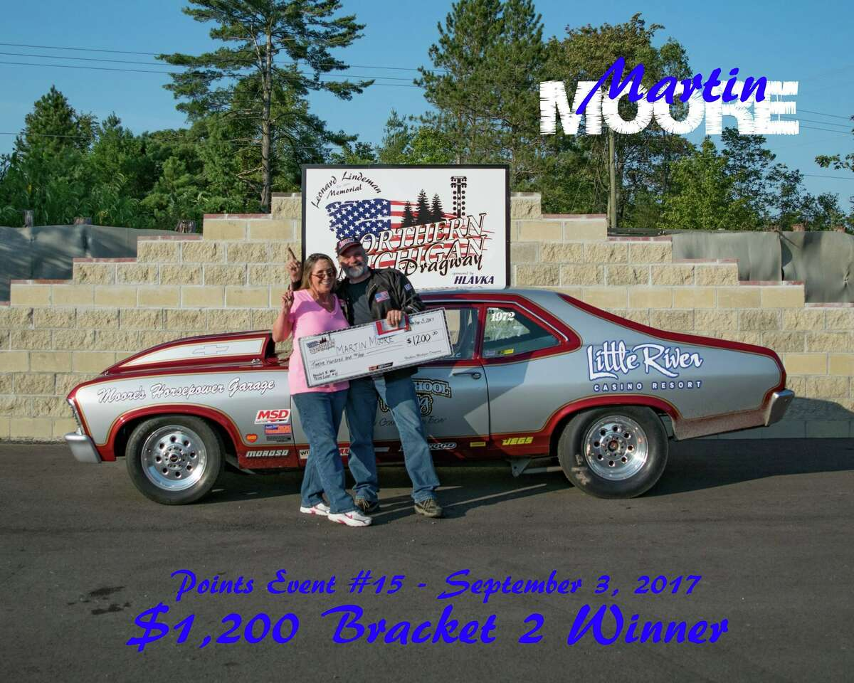 Left to right: Dorothy and Martin Moore celebrate a Bracket II victory.
