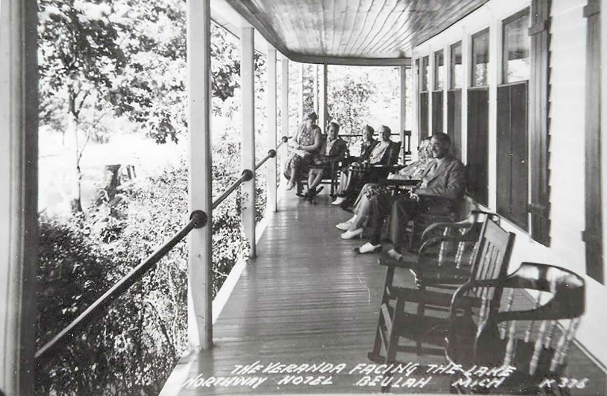 Guests dressed up for dinner relax on the veranda overlooking Crystal Lake after dinner at the Northway Hotel, circa 1940. (Courtesy Photo)