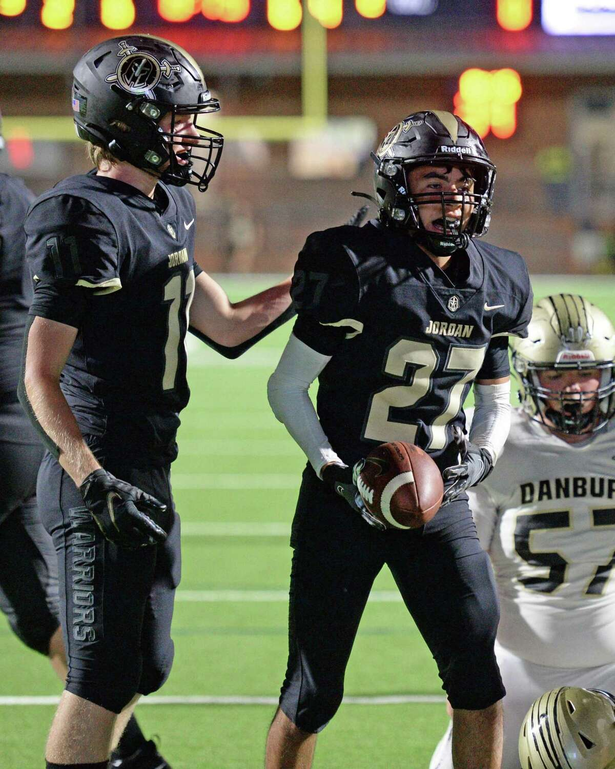 Kanaan Ibarra (27) and Ethan Beach (11) of Jordan react after a touchdown during the fourth quarter of a non-District football game between the Jordan Warriors and the Danbury Panthers on Friday, September 3, 2021 at Rhodes Stadium, Katy, TX.