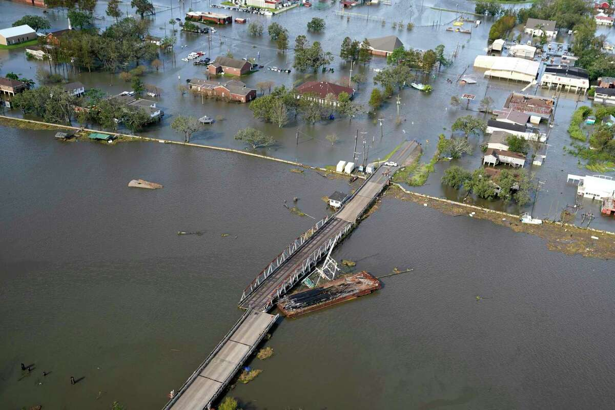 A barge settles on a bridge in the aftermath of Hurricane Ida, Monday, Aug. 30, 2021, in Lafitte, La.