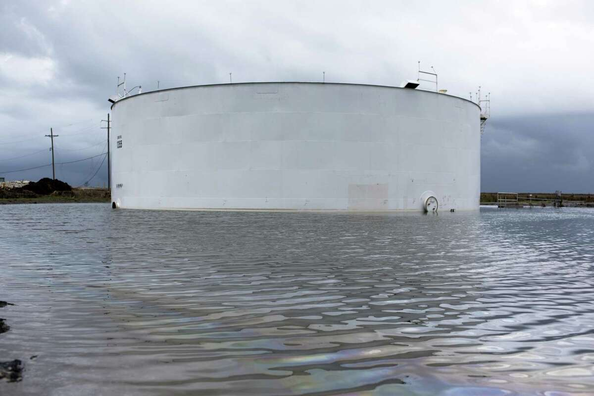 An oil tank surrounded by water after Hurricane Ida near Cocodrie, La., on Wednesday, Sept. 1, 2021. The Energy Department lowered its oil production estimates in the U.S. Gulf of Mexico after Hurricane Ida temporarily shuttered the vast majority of offshore oil platforms last month.