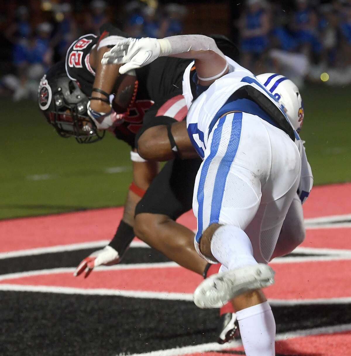 Port Arthur Memorial's Adrian Hayward dives into the endzone against Barbers Hill during their match-up Friday in Port Arthur. Photo made Friday, September 3, 2021 Kim Brent/The Enterprise