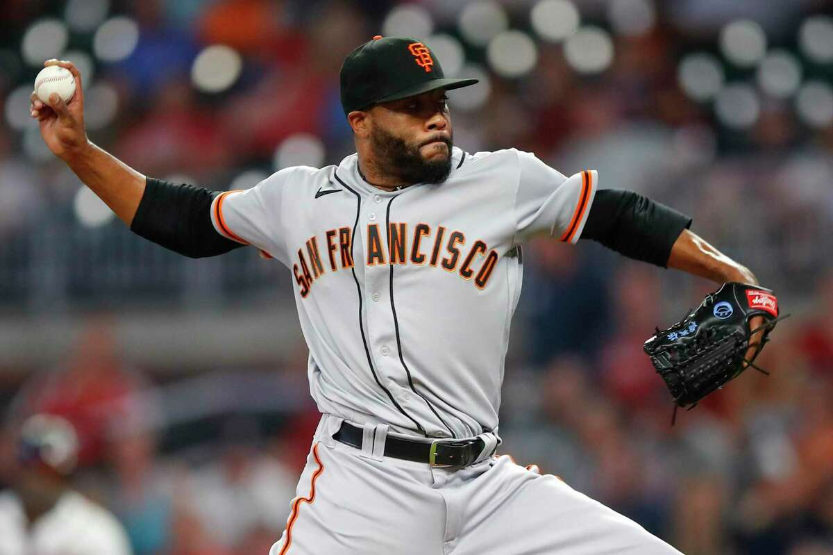 ATLANTA, GA - AUGUST 28: Jay Jackson #65 of the San Francisco Giants delivers a pitch in the ninth inning of an MLB game against the Atlanta Braves at Truist Park on August 28, 2021 in Atlanta, Georgia. (Photo by Todd Kirkland/Getty Images)