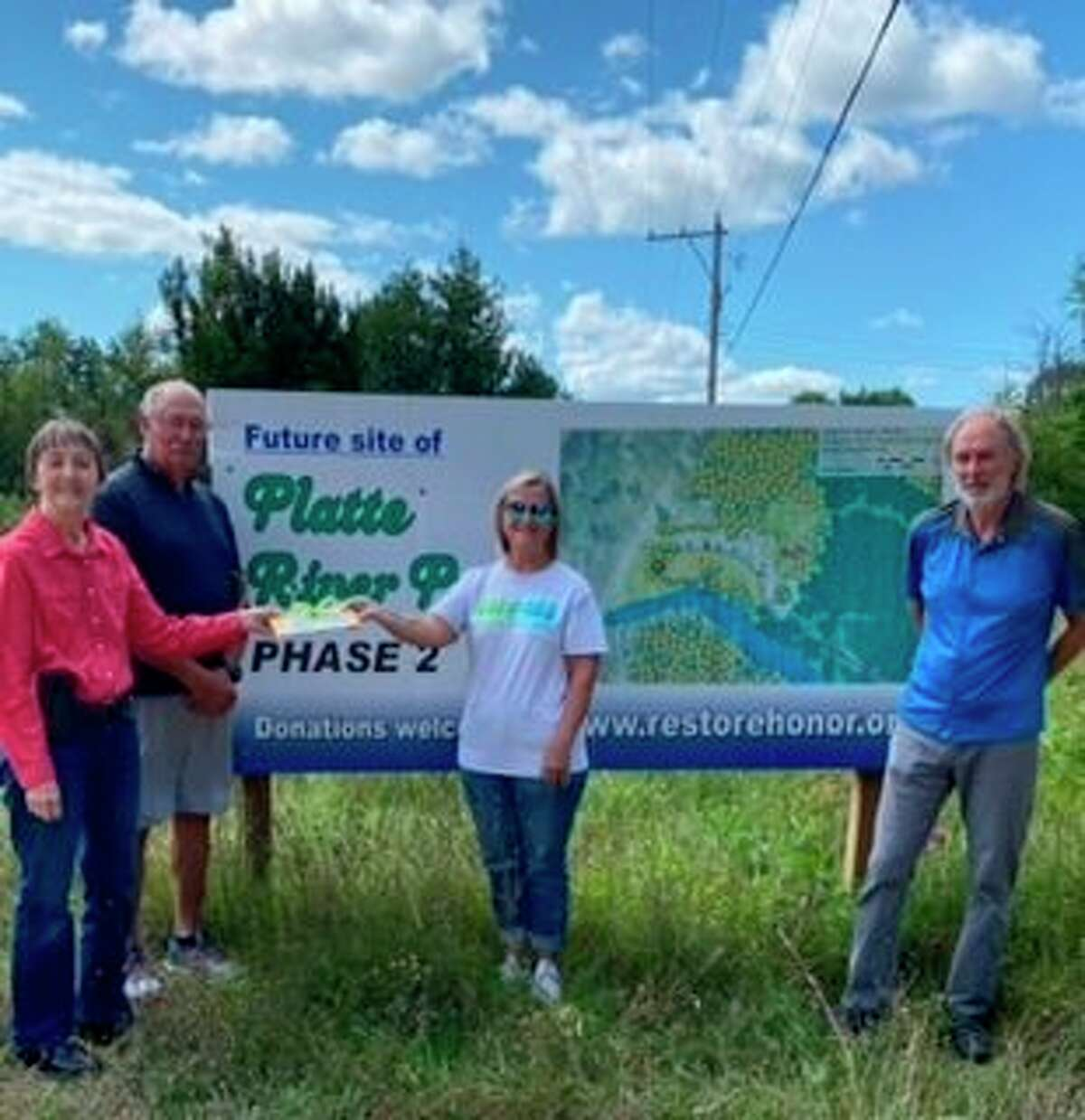 The 100+ Women Who Care of Benzie County presented$12,800to the Honor Area Restoration Project (H.A.R.P) for the PlatteRiver Park project. (Courtesy Photo)