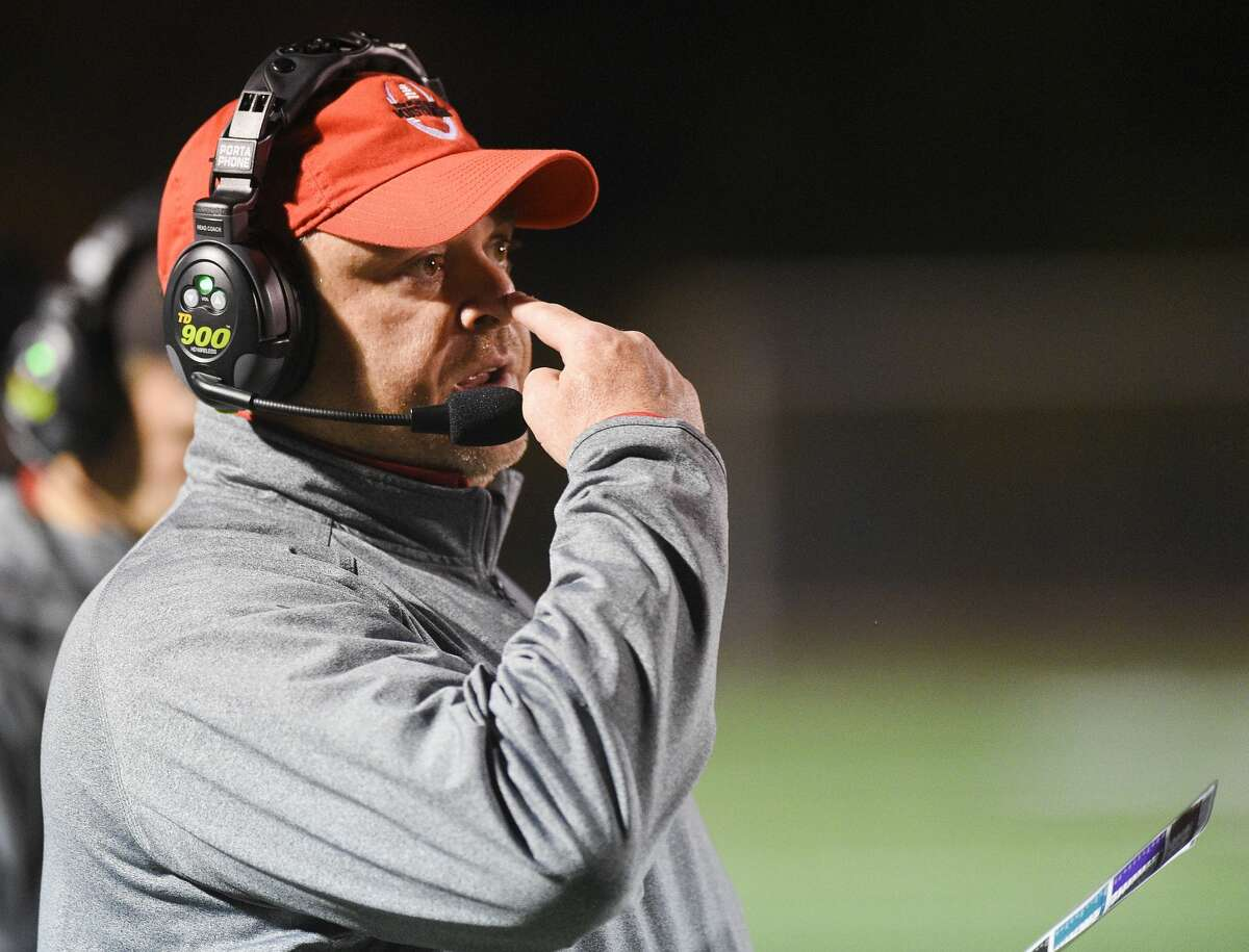 Fairfield Warde coach Duncan DellaVolpe signals the play to his team in the first half against New Milford during an alliance football game at Fairfield Warde High School in Fairfield, Conn. on Oct. 25, 2019. Warde defeated New Milford 34-21.