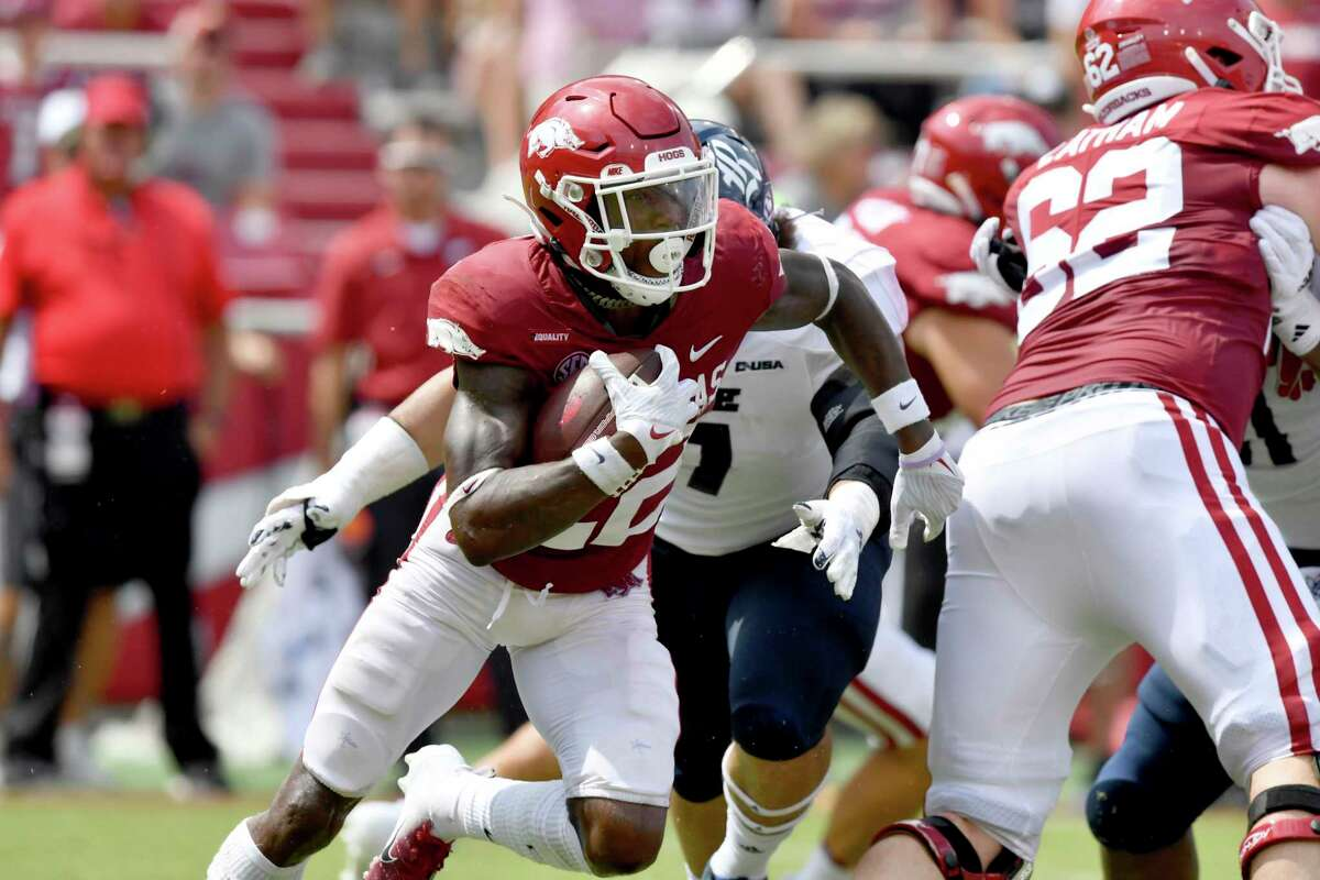 Arkansas running back Trelon Smith (22) runs the ball against Rice during the first half of an NCAA college football game, Saturday, Sept. 4, 2021, in Fayetteville, Ark. (AP Photo/Michael Woods)