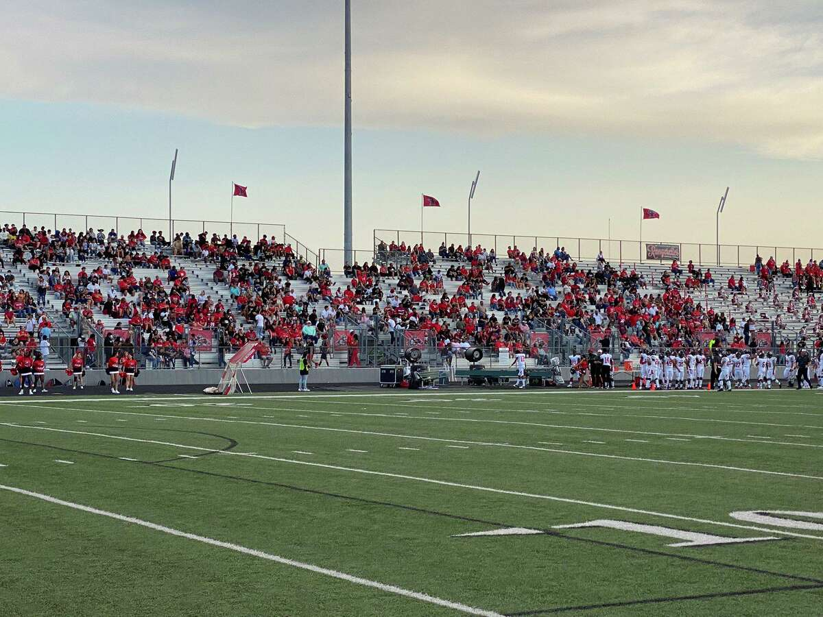 Terry High School fans celebrate as the Rangers took the initial lead Sept. 3 at Traylor Stadium. Terry defeated rival Lamar Consolidated 17-14 in the annual Battle of the Berg.
