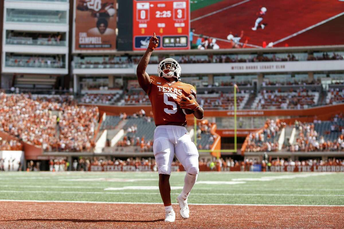 Texas' Bijan Robinson opened the season with a career-best four receptions with a pair of touchdowns.