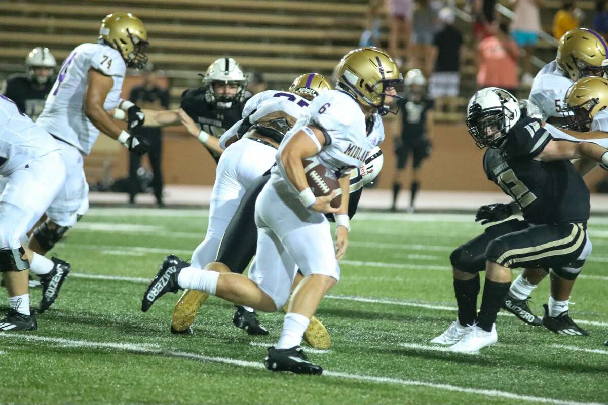 Midland High's Landry Walls (6) runs with the ball against Amarillo High at Dick Bivens Stadium on Friday night.
